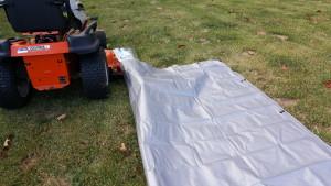 Drag the tarp over the chute
